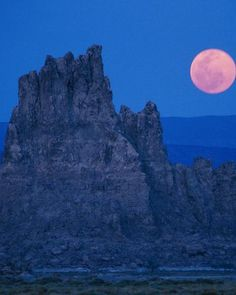 The moon rises over Djibouti's travertine chimneys, created by deposits from hot springs.  Photograph by Carsten Peter