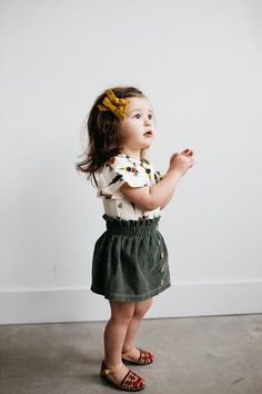 This skirt is the cutest little addition to your babes summer wardrobe! The green corduroy and tan buttons down the front give this skirt a vintage, throw-back look! Wear all spring long with a onesie