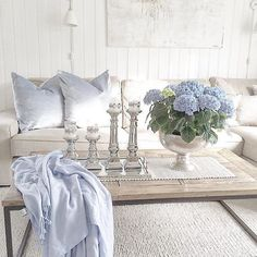 Word sleek springs to mind. Loving the pop of colour. Credit  @villavang #inspiration #interior #interior125 #interior4all #interiordesign #home #candlesticks #candles #blooms #flowers #neautrals #coffeetable #furniture #pillows #white #wood #whitewalls #art #wallart #walldecor #rug #sleek #style #house #houzz #followme #instadaily #picoftheday #inspiration #inspire_me_home_decor #homeadore by velvetmusings