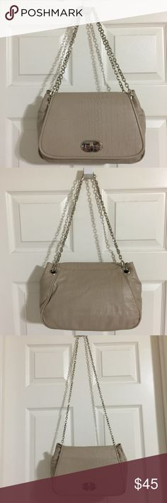 """Chico's Convertible Crossbody Shoulder Bag NEW WITHOUT TAGS Chico's Convertible Crossbody/Shoulder Bag with Silver Chain Strap  * Comes from a smoke free pet free environment   • Color: Taupe  • Dimensions: 11"""" L x 7"""" H x 4"""" D • Double strap drop: 11"""" • Single strap drop: 22"""" • Interior: Coral lining, 1 zipper compartment and 2 slip pockets  • Turnlock Closure • Silver tone hardware • Reptile embossed faux leather  🎀 I have more CHICOS, Check out my other items!  ❤ LIKE ME ON FACEBOOK…"""