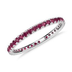 Gift mom with this gemstone eternity ring featuring a petite row of rubies this Mother's Day.