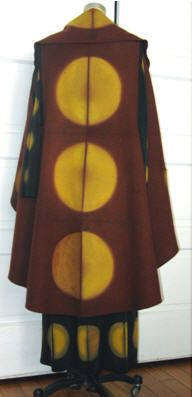 The power of the itajime technique in Angelina DeAntonis' Ocelot dress and cape ensemble is fluid and strong.  The special combination of wool, silk and natural dyes creates a majestic feel and presentation. Yellow, rust-brown and black are the distinctive  colors created from osage, cochineal, cutch, iron & logwood, and acid dyes for the deep           ... » Read the Rest » ...