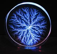 High voltage discharges to the surface of water can also create Lichtenberg figures. Some very beautiful examples of both positive and negative Lichtenberg figures on water surfaces