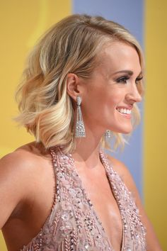 Carrie Underwood Photos Photos - Singer-songwriter Carrie Underwood attends the 50th annual CMA Awards at the Bridgestone Arena on November 2, 2016 in Nashville, Tennessee. - The 50th Annual CMA Awards - Arrivals