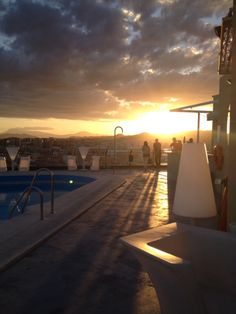 Roof top drinks with a Malaga sunset.