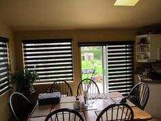 HiLite shades in a Kitchen, patio doors and windows.  These unique shades go by many names, Ambio, Hi-Lite, Mandalay and others.  Their low profile, modern look and multi-functionality and very reasonable price makes these a popular choice.  At Shades of Home our everyday price starts at 50% of the MSRP