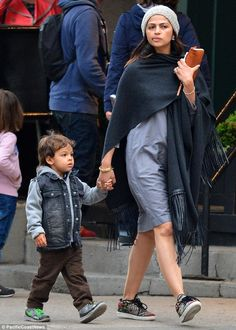 Off duty:Camila Alves went make-up free while out with her son Livingston, three, in New ...