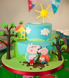 So here it is! Popular the world over with boys and girls, Peppa Pig is a common request at so many children's parties. After lots of research Paul decided to go for 2D style models on a 3D cake!