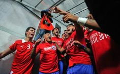 Chile players celebrate after their 2014 World Cup