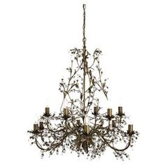 An opulent addition to your dining room or kitchen, this stunning chandelier features crystal droplet detailing. Pair with all-white decor and white marble countertops for an elegant look.  Product: ChandelierConstruction Material: Metal and crystalColour: BrownFeatures: Twelve armsDroplet detailingAccommodates: (12) E14 40 Watt bulbs - not includedDimensions: 86 cm H x 87 cm Diameter