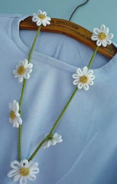 """Free knitting pattern for Daisy Chain Necklace of icord - Crazy Dazy designed this necklace with i-cord flowers and """"chain""""."""