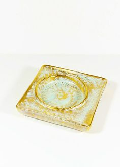 Glam it up with this amazing vintage Hollywood Regency-style ceramic ashtray, from Trenton, NJs Stangl potteries. This ashtray is in excellent vintage condition with no signs of use and is brushed all over in gold glaze then daubed with a copper patina-like grayish blue overglaze,