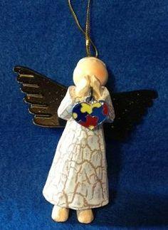 Autism Angel with Puzzle Heart and Praying Arms HugsNStitches4u,http://www.amazon.com/dp/B009WAE79E/ref=cm_sw_r_pi_dp_bhr9sb0X05FF36RF