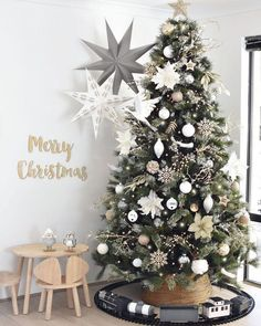 Christmas tree is up 🎄🎄🎄 This year I've done white, silver, wood, gold & grey decorations! The train is from and I have painted… Christmas Tree Colour Scheme, Minimalist Christmas Tree, Christmas Tree Inspiration, Silver Christmas Tree, Christmas Tree Design, Colorful Christmas Tree, Christmas Tree Themes, Noel Christmas, Green Christmas