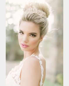 There is something so pretty and elegant about a high bridal bun, also known as a ballerina bun. We've rounded up 16 gorgeous looks; some sleek, some curled or tossled, some wrapped with braids. If this is a style that you are contemplating for your big day, you'll find some beautiful inspiration below. Photo above and below: …