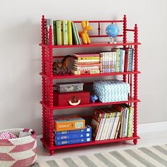 Jenny Lind bookcase in raspberry from Land of Nod. Perfect for that pop of colour.