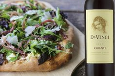 Tuscan Style Prosciutto, Fig and Greens Pizza paired with DaVinci Chianti