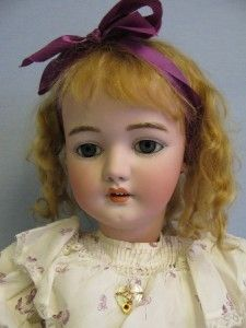 """Antique (circa 1890) Simon & Halbig doll. 31"""" tall with sleep eyes, upper teeth, and spiral glass blue eyes. Her bisque head is incised """"S & H 1079 // DEP // Germany // 14 1/2"""","""