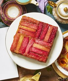 A layer of fresh rhubarb gives this traditional upside down cake a pretty pink makeover. The tender vanilla and citrus-kissed cake is the perfect companion for tart, jammy fruit.