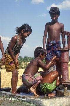 Young Children happy with clean Water from a new Water Pump, Bhola Island, Bangladesh.