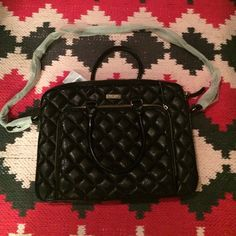 Kate Spade Janine Gold Coast black cross body bag NWT - This beautiful Kate Spade bag has a long strap for a girl on the go. It is black with a slight gold shimmer. Perfect for carrying a laptop and personal items. Great for any gal on the gal. Brand new with tags. A must have!  kate spade Bags Crossbody Bags