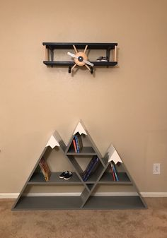 Adorable wooden bookcase and shelf that look like an airplane flying over mounta. Adorable wooden bookcase and shelf that look like an airplane flying over mounta. Wooden Wall Decor, Wooden Walls, Wall Art Decor, Baby Boy Rooms, Baby Boy Nurseries, Baby Room Decor, Nursery Decor, Nursery Room, Deco Cool