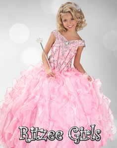 For the Frilly Princess   Ritzee Girls Pageant Dress 6348. This floor length pageant gown displays off the shoulder sleeves, gorgeous floral embroidered bodice, and a basque waistline. Completing the look of this dress is a ruffled ball gown skirt.  Available in Pink/Neon Pink, Pink/Black, Red and Royal.