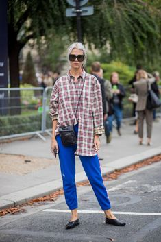 The next time you're borrowing a flannel or button-down from your SO's closet and it's too big, use the half-tuck to make it look more fitted.