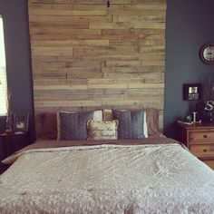 Floor to ceiling headboard made from pallets. Sanded and whitewashed with a frame built underneath on each stud for better support and fewer holes. :))