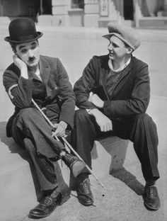 Chaplin and a grown Jackie Coogan on the Modern Times set, 1935.