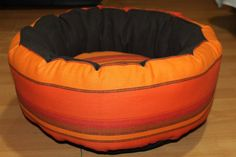 Handmade bed for cats/small size dogs,manually sewn and finished,made from natural materials, diameter 48 cm, depth 23 cm,filled with silicon fluff and comfortable for any furry pets.Removable cushion.Unique design! The round shape of the bed and high margins are ideal for squatting and provides a sense of security for the pet . The bed is washable at 30 ° C .