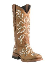 Lucchese's signature Angelina stitch and stud detailing follows this western boot from horseman square toe to shaft. It's fashioned from genuine leather and features embellished pull-on straps and a sturdy stacked heel.