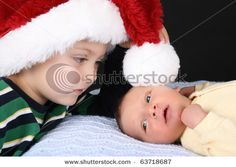 Older sibling with newborn. #Newborn #Christmas #Photography