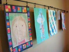 run a long curtain rod along the wall and use shower curtain clips to hold art and papers