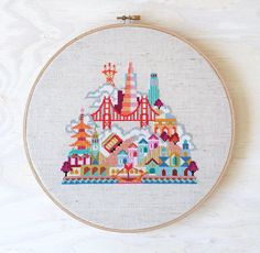 This modern cross stitch pattern of San Francisco features the Golden Gate Bridge, the Transamerica Pyramid, Sutro Tower, Coit Tower, the Palace of