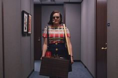 Yep. I want to feel like Peggy looks here...not the hungover from drinking vermouth for 16 hours part. NO. The I can handle it part; I've got my life in a box and I'll figure it out part.