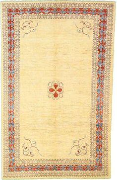 6' 2 x 9' 9 Floral Modern Ziegler Rug This Vegetable-dyed Oriental Floral Modern Ziegler rug is Hand Knotted of 100% Hand Spun Wool and has 200 knots per square inch. Colors found in this rug include: Cream, Red, Blue. The primary color is Cream. $2655