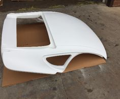 Homepage for the custom cayman style hardtops, side and rear replacement glass, and liners for the 986 and 987 Porsche Boxster, based out of Brunswick Ohio.