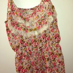 Floral Tank Top Loose fitting floral Ruffled tank top. Minimally worn, in great condition. Great for a summer outfit with a cute pair of shorts! Tops Tank Tops