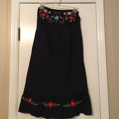 Strapless black embroidered dress! Cute cotton black dress. Elastic in the back. Embroidered at top and bottom. Dresses