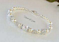 Hecho con perlas de vidrio de 6mm marfil, perlas de 4mm cristal marfil, perlas de cristal de 6mm, 8mm cristal beadand un 8mm cristal de Swarovski. Personalizado tamaño disponible.