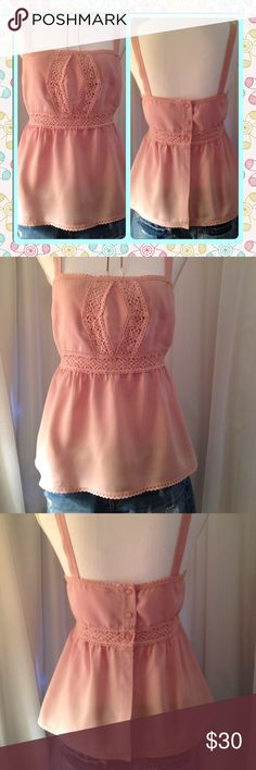 Lace Trimmed Tank Adorable Boho crochet lace trimmed tank in a dusty rose pink color. 3-button closure in back. Great with your favorite cut-offs or dress it up under a suit! So versatile. Never worn. Purchased in a local Boutique downtown. *Shorts are in a separate listing- bundle and save! Rush Tops