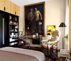 An imposing painting by Mark Beard presides over the neutral guest room in a New York apartment.