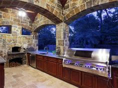 An outdoor kitchen can be an addition to your home and backyard that can completely change your style of living and entertaining. Earlier, barbecues temporarily set up, formed the extent of culinary attempts, but now cooking outdoors has become an. Back Patio, Backyard Patio, Backyard Ideas, Outdoor Cooking, Outdoor Kitchens, Rich Home, Backyard Paradise, Mansions For Sale, Summer Kitchen