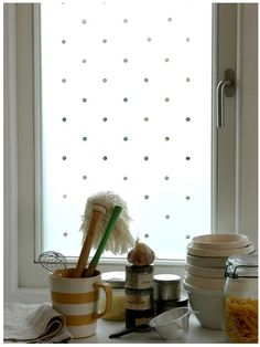 Polka-dot decorative film! Would love something like this for sliding glass door.