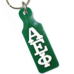 Alpha Epsilon Phi Large Paddle Keychain with a Mirror on the back. This keychain comes as shown.