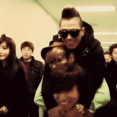 Daesung gives a piggyback to TOP and Taeyang (gif)