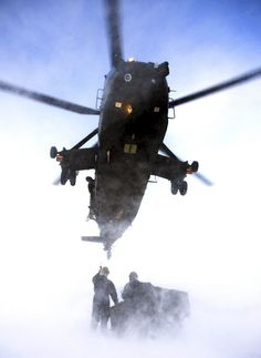 The Maritime Air Prize. Awarded for the best photograph of one or more Royal Navy helicopters, this category is specifically for rotary wing images. Commended. Caption: Royal Navy Sea King Mk4 helicopter pilots and aircrews from Commando Helicopter Force (CHF) carry out a load lifting exercise as part of their arctic flying training, the training takes place some 200 miles inside the Arctic Circle at the Joint Helicopter Command (JHC) base near Bardufoss, Norway.
