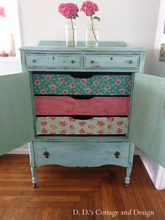 love the paint colour and the walpapered drawers!