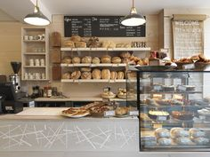 London firm Paul Crofts Studio completed this bakery on a high street in Suffolk, UK, with a motif based on a magpie's nest set into the douglas fir serving counter. Bakery Cafe, Bakery Store, Bakery Display, Bakery Decor, Pub Decor, Bakery Shop Design, Coffee Shop Design, Restaurant Design, Bakery Shop Interior